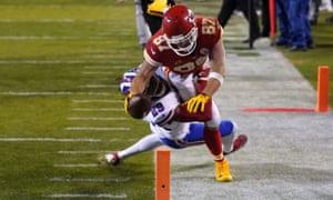 Travis Kelce (87) dives toward the goalline over Buffalo Bills cornerback Josh Norman (29)