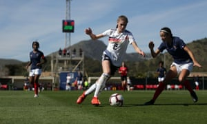 Germany's Jule Brand attempts to go past France's Kessya Bussy during Germany's 2-1 win in their Under-19 La Manga tournament match in Spain.