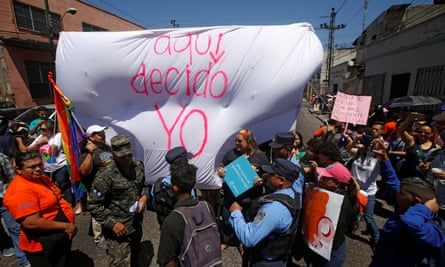Demonstrators in Tegucigalpa, the capital of Honduras, brandish mock underwear emblazoned with the slogan: 'I decide here'
