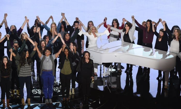Lady Gaga performs Til It Happens to You on stage with survivors of sexual abuse