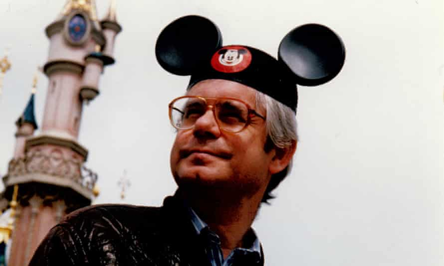 Simon Hoggart wearing a Mickey Mouse ear hat at Paris Disneyland