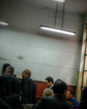 Ahmed Naji (centre background) glimpsed at his court appearance in February 2016.