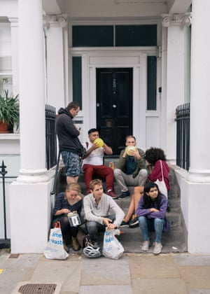A group of friends gather on the steps of a house in Powis Square to inhale laughing gas.