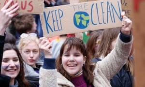 People holding placards take part in a demonstration against climate change in Brussels, Belgium,