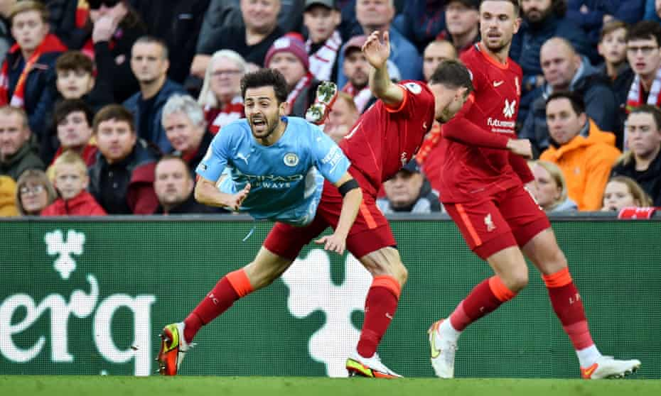 James Milner (middle) sends Bernardo Silva flying but the Liverpool right-back was not shown a second yellow card.