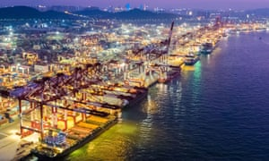 An aerial night view of a container port in Qingdao in east China's Shandong province.