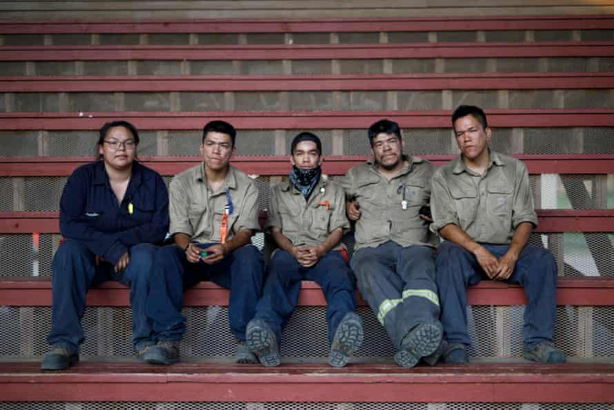 From left, Bryden Williams and partner Ryan Webster, along with brothers Wade, Wayne, and Mathew Webster are photographed after their firefighting shift at the Tk'emlups pow-wow grounds.
