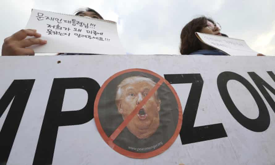 South Korean protesters stage a rally against a planned visit by Donald Trump.