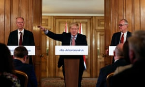 From left: chief medical officer for England, Chris Whitty; Boris Johnson; and chief scientific adviser Sir Patrick Vallance attend a news conference.