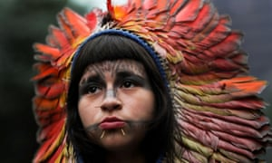 A woman in indigenous dress at a demonstration an International Women's Day protest in Brazil. Brazil's president, Jair Bolsonaro, has introduced drastic measures to force Brazil's indigenous populations from their lands.