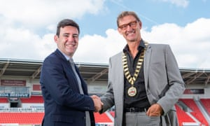 Andy Burnham hands the presidential chains of the Rugby Football League over to Tony Adams