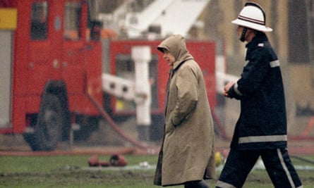 The Queen surveys the scene at Windsor Castle after the fire in 1992.