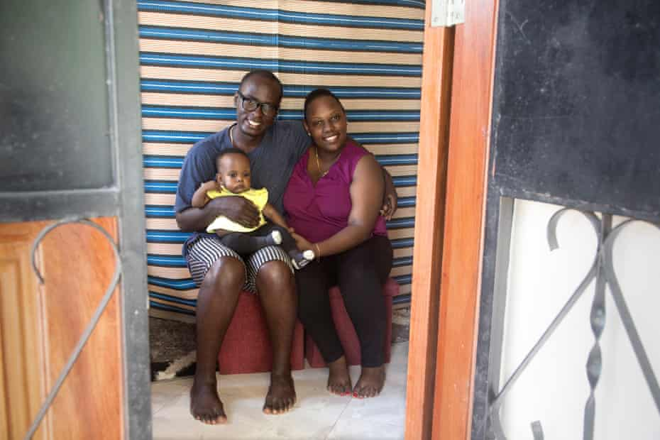Albert Monyo, 32 and his wife, Beatrice, 31, with their seven-month-old daughter, Audrey, at their home in the city of Dar es Salaam, Tanzania.