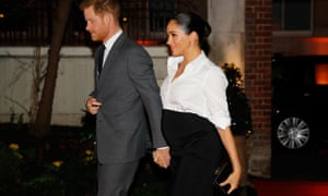 Prince Harry and Meghan hold hands on their way to an awards ceremony