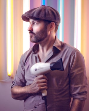 man with hairdryer