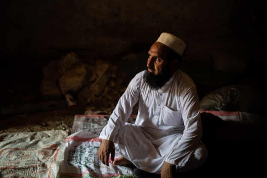 Khayal Muhammad sits in a cave in the village of Charwazgi Mulankali near Peshawar, Pakistan.