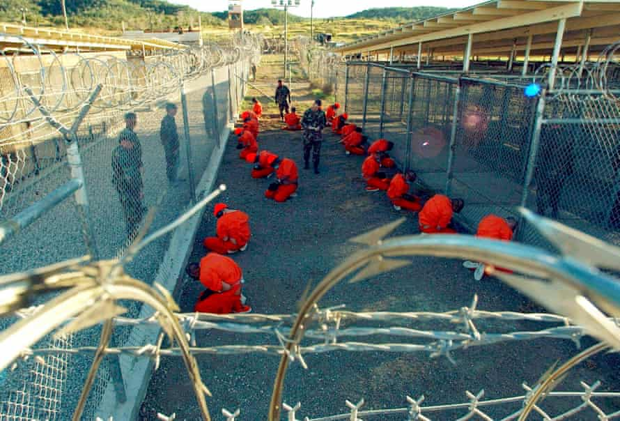 Detainees sit in a holding area in Guantanamo Bay. Trump has vowed to expand the prison.