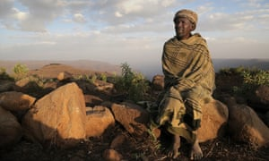 A farmer wrapped in a blanket in Ethiopia's Janamora district