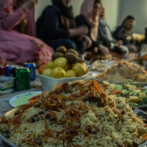 Families gather during Nowruz to share palau, a traditional meal of rice, meat and vegetables.