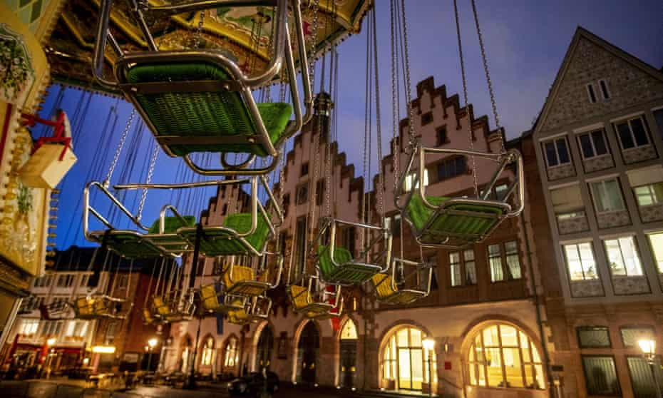 An empty carousel outside the town hall in Frankfurt, Germany, where an evening entertainment curfew has been imposed.
