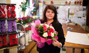 Florist Tara Patel holding flowers