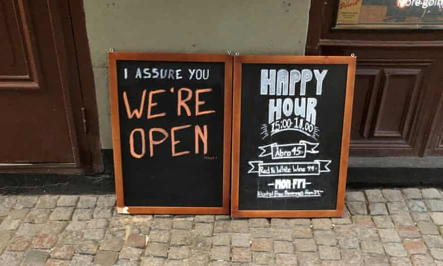 Signs outside a Stockholm bar last week.