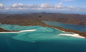an aerial view of the Great Barrier Reef off the coast of the Whitsunday Island