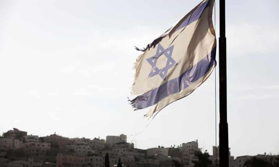 An Israel flag flies near a Jewish settlement in Hebron West Bank Palestinian Territories. Israel is refusing to issue visas to Human Rights watch, accusing the NGO of having a 'hostile' agenda in its reporting of human rights violations.