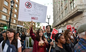 Protesters march against racism in Oakland, California, in response to a series of violent clashes at a white nationalist rally in Charlottesville, Virginia.