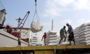 Wheat given by Unicef being unloaded at Hodeidah, where 70% of Yemen's imports arrive.