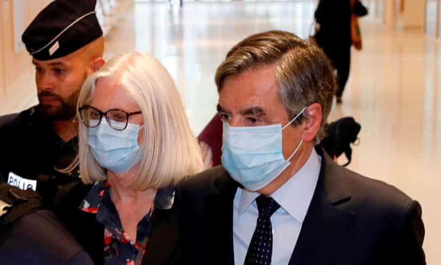 Former French prime minister François Fillon and his wife Penelope at court in Paris on 29 June.