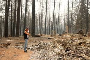 Fred Batten looks at debris after the Caldor Fire overran the El Dorado county town of Grizzly Flats.