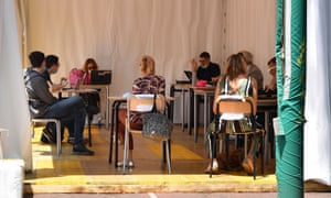 Students take the esame di maturita exam in a tent outside the JF Kennedy High School in Rome.