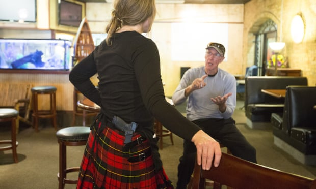 With a 9mm Smith and Wesson secured in her kilt, Monika Siebers talks with a customer.