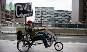 A protester rides past the Hennepin county government center on Monday