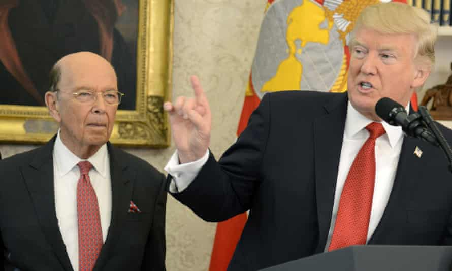 Donald Trump makes remarks in the Oval Office as commerce secretary Wilbur Ross listens.