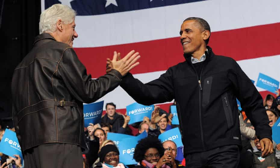 Bill Clinton and Barack Obama at an election rally in 2012.