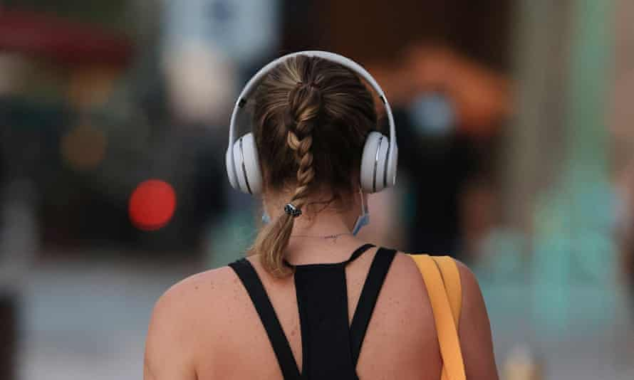 Back of woman's head with headphones on