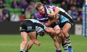 Cameron Munster punctures the Cronulla defence.