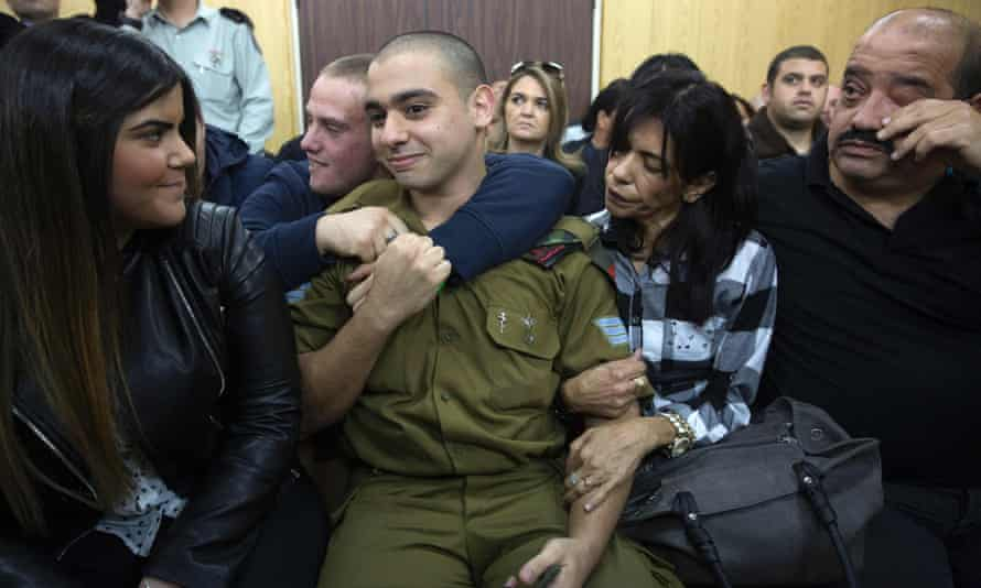 Elor Azaria sitting with his parents and his girlfriend Orel (left) as he awaited the verdict at the military court in Tel Aviv on Wednesday.