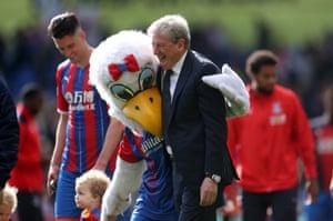 Crystal Palace mascot 'Alice The Eagle' gives manager Roy Hodgson a hug.