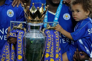 The son of Jeff Schlupp holds the trophy after the Premier League trophy presentation