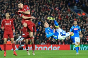 Napoli's Arkadiusz Milik in action with Liverpool's Dejan Lovren.