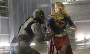Supergirl tackling villain