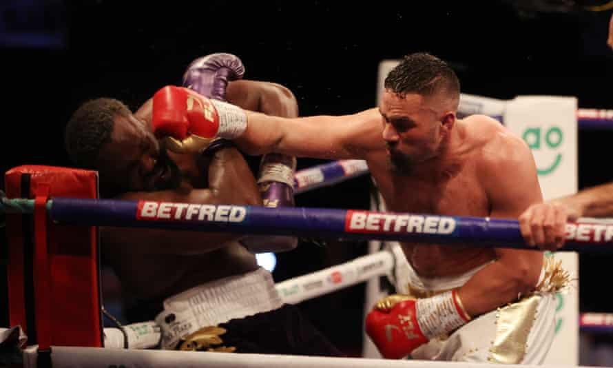 Joseph Parker pins Derek Chisora in a corner en route to winning their bout at the Manchester Arena