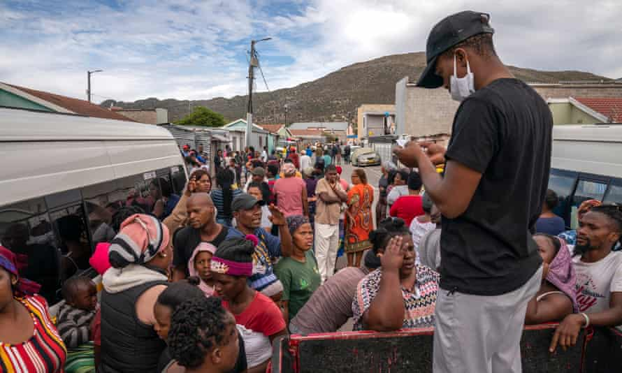 An aid worker delivers food parcels to vulnerable families near Cape Town, South Africa.