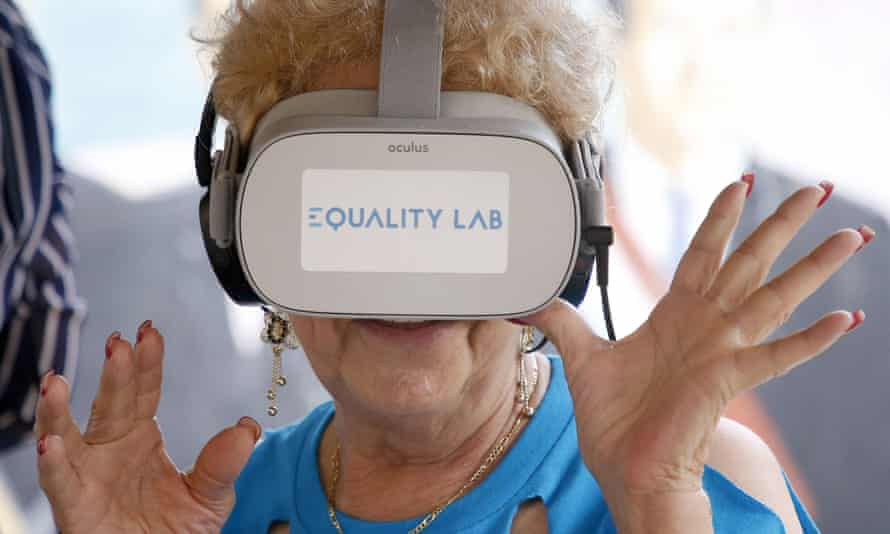 An elderly woman in Miami tests out a virtual reality device marketed to the elderly.
