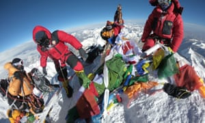Mountaineers and sherpas gather at the summit of Mount Everest in May 2018