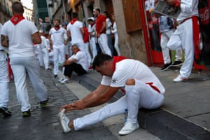 Pamplona, Spain Runners wait for the start of the running of the bulls during the San Fermin festival