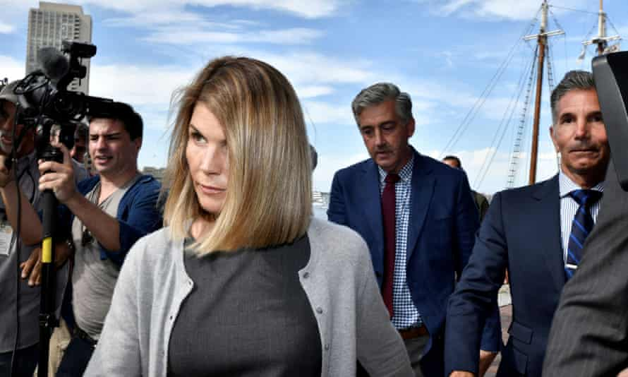Lori Loughlin and Mossimo Giannulli leave court in Boston in August last year. On Friday the judge said he will decide whether to accept the plea deals after further consideration.